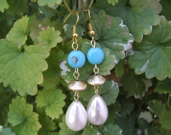 Charming elegant goldtoned dangle earrings with genuine white pearl and turquoise.