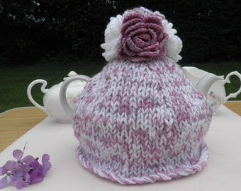 Rosie Raspberry Ripple Cosy - chunky hand knitted cosy in white and pink with flamboyant matching rose decoration