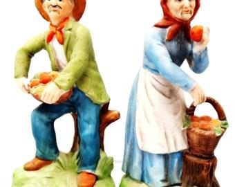 Vintage Figurine Pair of Old Man and Woman Bisque Porcelain Holding Fruit Basket