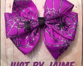 ON SALE NOW Purple spider and web pinwheel bow on partially lined alligator clip with no slip clip - 4 inches across - perfect for Halloween