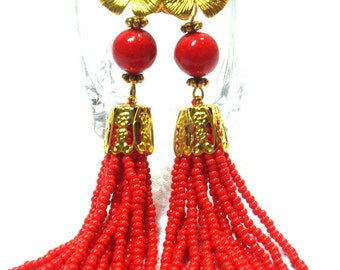 long beaded earrings and coral beads