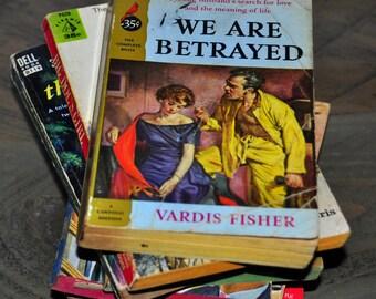 Paperback Books. Romance Novel. Old Paperback. 1950s Paperback. Vintage Romance Paperback. We Are Betrayed. Vardis Fisher. Cardinal Edition.