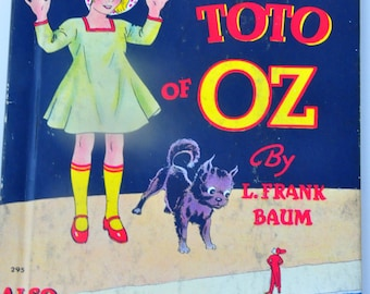 Wizard of Oz Book. L. Frank Baum. 1939 Little Dorothy and Toto of Oz. The Cowardly Lion & the Hungry Tiger of Oz. The Wizard of Oz. Baum.