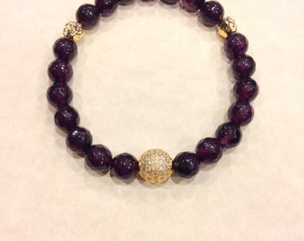 Genuine Garnet stretch bracelet with Gold plated details