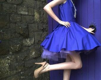 Purple dress and purple tutu. Alice In Wonderland.