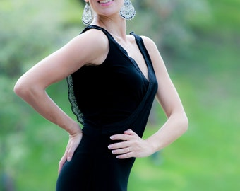 Black maxi dress for bridesmaids with an open back .