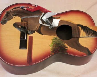 SOLD...Hand Painted Equestrian Guitar. Jumping Horse fits perfectly to the curve of the guitar.
