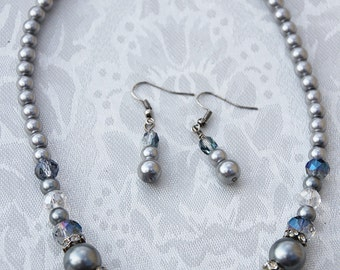 849-Necklace and earrings in Silver glass pearls and beads