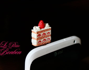 A slice of Strawberry short cake cell phone plug charm