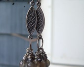 Earrings featuring Vintage Silver Tone Etched Olong Drops dangling 3 hand Wire Wrapped Labradorite Rounds