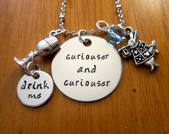 """Wonderland Inspired Necklace. """"Curiouser and curiouser"""". Drink me. Silver colored.  Swarovski Elements crystals."""