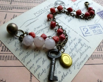 Assemblage Charm Bracelet with Vintage Key, Brass Locket, Rose Quartz Stone, Recycled Glass Beads. Rustic Romantic. Eco Chic Jewelry