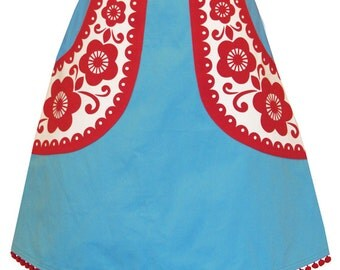 pocketful of posies skirt - turquoise and red - graphic flowers screen printed on big pockets, trimmed with pom pom fringe