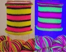 Black-light fluorescent yarn! Evil Genius: Hand-dyed gradient self-striping sock yarn, 80/20 SW merino/nylon