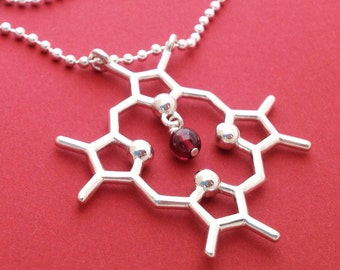 heme molecule necklace with garnet in solid sterling silver