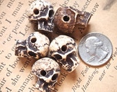 5 Cast Powdered Bone and Resin Skull Beads with a Horizontal Hole