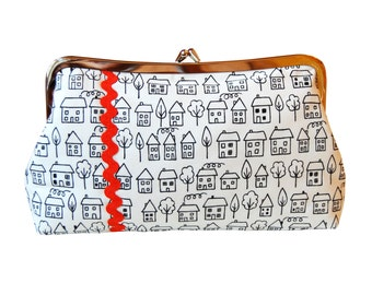 Clutch purse with hand-drawn houses in black, white, and orange