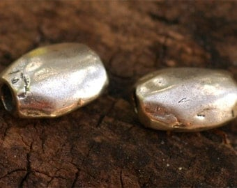 Two Sterling Silver Olive Beads DL11