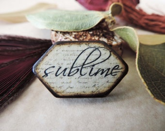 """Cream Black antiqued Script """"Sublime"""" Inspirational Wood Burned 1 1/4"""" x 3/4"""" ART Tile double Pentagon shaped pendant charm"""