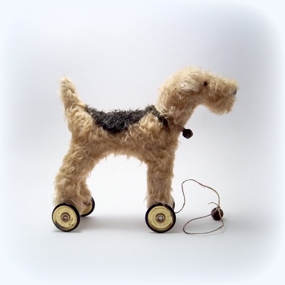 Little Lakeland Terrier on vintage Meccano wheels