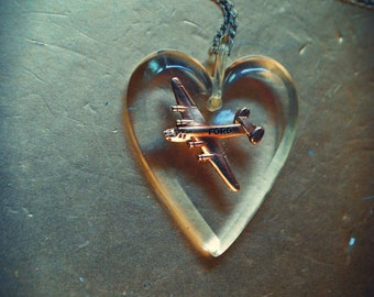 Panam vintage 50s clear lucite heart pendant with a brass air plan.Sterling silver 925 chain.