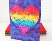 All You Need Is Love-  A colourful card with a rainbow heart and positive quote from an original felt painting.