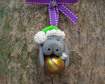 Santa Manatee Holding Lime Green Christmas Ball Ornament