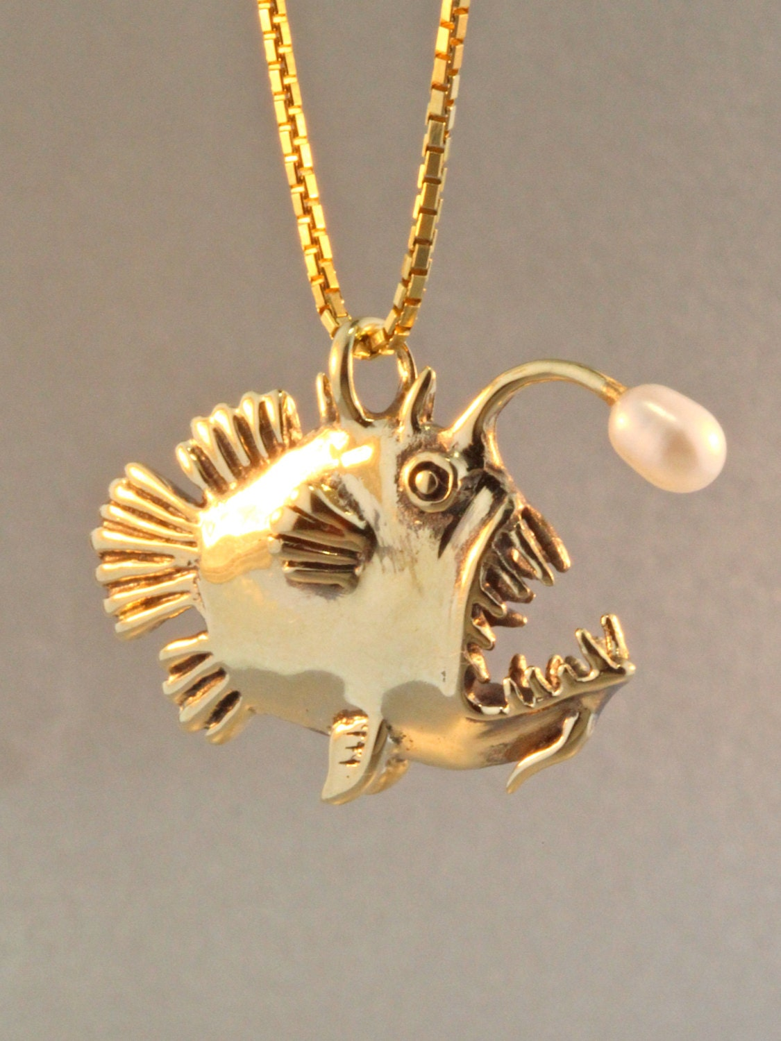 Gold angler fish charm pendant with pearl angler by martymagic for Gold fish charm