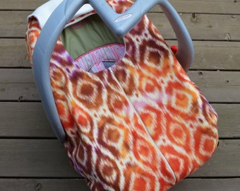 Ikat Baby Car Seat Cover in Tangerine, Rust and Plum, by Sophie Marie Designs