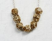 Gold glitter resin sparkle geometric bead necklace.