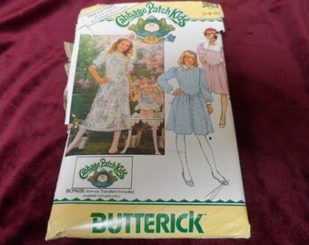Butterick 3653 Girl's Dress Pattern Cabbage Patch Doll Dress Pattern and Iron ons.