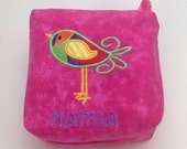 Small lined pink cosmetic bag with bird applique and zipper closure