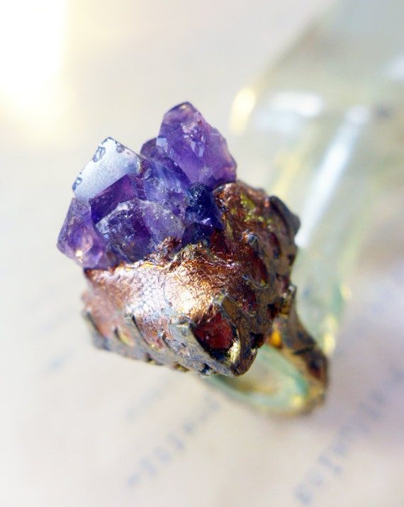 Raw amethyst in deep purple on chunky oxidized ring with coppery gold leaf. Animate.