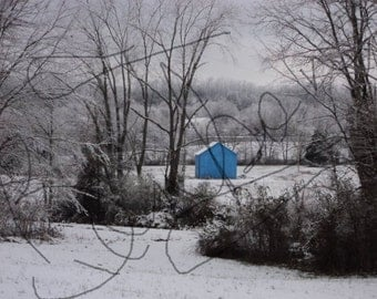 Digital picture blue barn in a snowy field