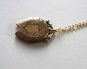 HORSESHOE SHIELD victorian rolled gold paste antique locket