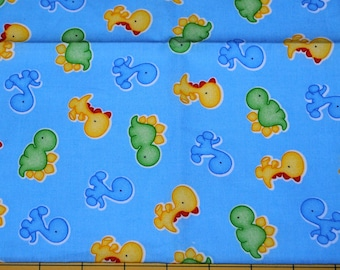 Fat Quarter Adorable Baby Dinosaurs on Light Blue Background Fabric