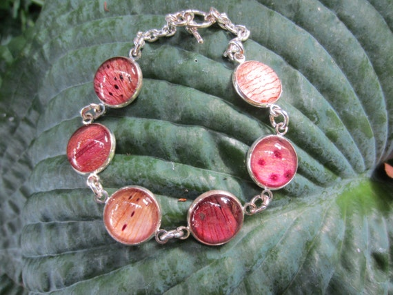 Pressed flower Cabochon Charm Bracelet. Real Lily/Tulip petals behind glass.