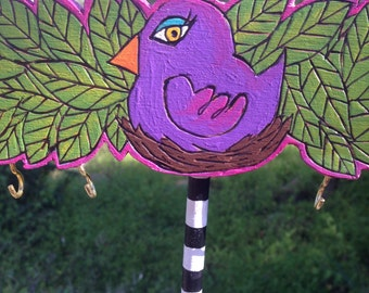 Purple bird jewelry holder