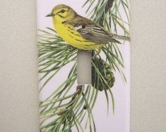 Single yellow bird on pine bough light switch cover switchplate