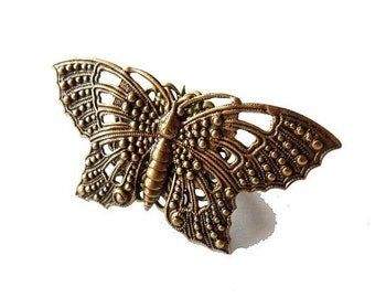 As Seen at the GBK Celebrity Gifting Suite - 2015 Emmys, Worn by Actress Renee Olstead. Butterfly Ring, ornate antiqued brass
