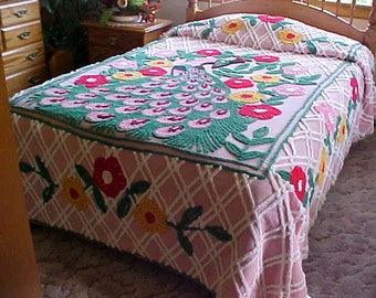 Beautiful peacock chenille bedspread with pink background and vivid colors on flowers and feathers -size is 98X88