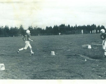 High School Football Game Player Running in Uniform Vintage Black and White Photo Photograph