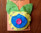 bright yellow fabric flower clip