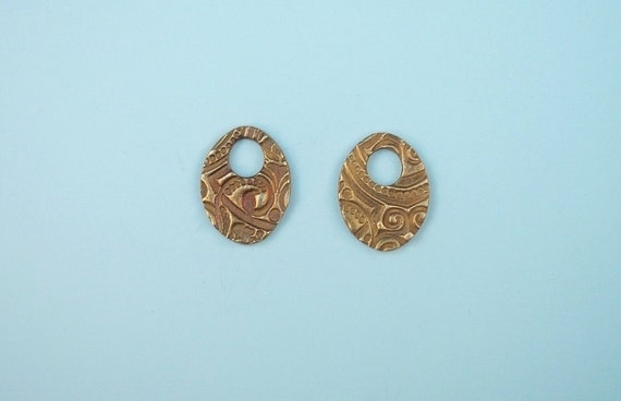 RESERVE LISTING Five pair large bronze oval cut-out bead