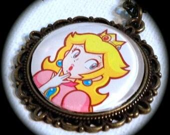 PRINCESS PEACH Surprise . Glass Pendant Necklace . NINTENDO . Super Mario Bros . Cosplay Kawaii . Videogame Gamer . GirlGameGeek