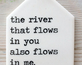 porcelain wall tag screenprinted text the river that flows in you also flows in me -kabir.