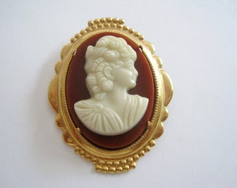 Vintage Gold Tone Cameo Brooch with a Dark Salmon Background and an Ivory Colored Cameo