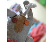 Natural linen bunny decorated with fabric pieces and buttons
