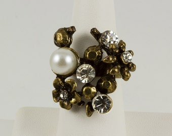 Costume Dinner Ring, 5 Cubic Zirconia 3 Large, 2 smaller as flower center, Large Faux Pearl, 3 Small Nail Heads, Stylized Design, Unique
