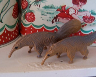 little plastic toy ant eater figurines
